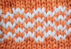 Orange texture knitted fabric Stock Images