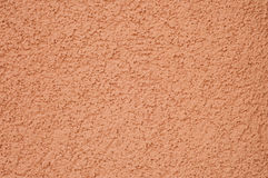 Orange textured concrete wall Stock Photo