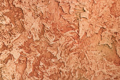 Orange textured decorative clay. For interior and exterior work stock images