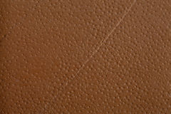 Orange Textured. Leather texture on the entire frame Stock Photography