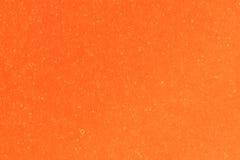 Orange textured sheet of cardboard Royalty Free Stock Images