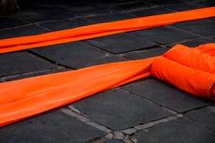 Orange Thai robes. Two orange robes lying on the ground Stock Image
