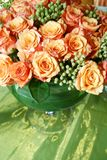 Orange thai roses 007. Bunch of fresh orange roses in a glass vase stock images