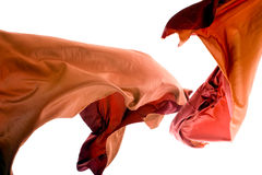 Orange Thai Silk in Mid-Air. Beautiful thai silk shot in mid-air in studio Stock Photos