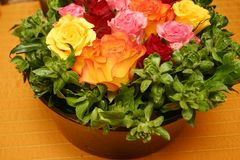 Orange thai theme 029. Bunch of fresh roses arranged in a festive bouquet stock image