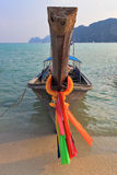 Orange Thai tourist boat moored on the beach Royalty Free Stock Image