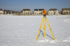Orange theodolite set in the field Royalty Free Stock Image
