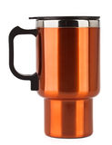 Orange thermos mug with black handle Royalty Free Stock Photos