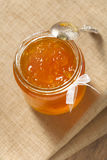 Orange thin cut marmalade or jam  in  jar Stock Image