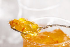 Orange thin cut marmalade or jam on a spoon Royalty Free Stock Image