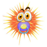Orange thorn ball with pacifier Royalty Free Stock Photo