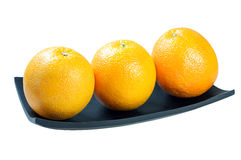 Orange. Three Orange on wooden tray on the white background, clipping path Stock Image