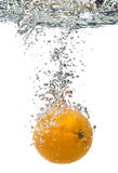 Orange thrown into water Stock Images
