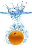 Orange thrown into water Royalty Free Stock Images
