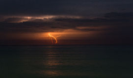 Orange Thunderbolt Across Body of Water Under Grey Clouds Royalty Free Stock Photos