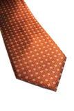 Orange Tie. A closeup of an isolated orange neck tie Stock Image