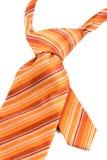 Orange tie close-up. Elegant casual orange neck tie on white Royalty Free Stock Images