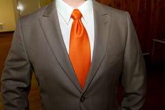 Orange Tie Groom Stock Photo