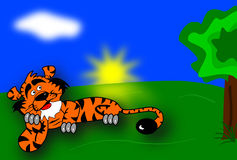 Orange tiger laying under a tree Stock Images