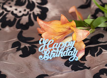 Orange tiger lily with blue happy birthday sign Stock Photos