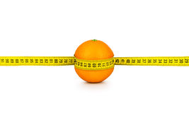 Orange tightened measuring tape Royalty Free Stock Photo
