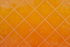 Orange Tile glossy mosaic Earthenware material background Royalty Free Stock Images