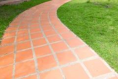 Orange tile walkway Stock Images
