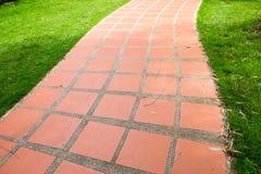 Orange tile walkway Stock Photo