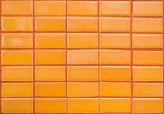Orange tile wall Royalty Free Stock Photography