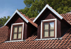Orange tiled roof and garret windows in old house Royalty Free Stock Image