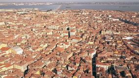 Orange tiled roofs of old buildings in Venice, Italy. Aerial shot Royalty Free Stock Photography