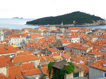 Orange Tiled Rooftops of Dubrovnik Old City and the Green Lokrum Island, Dubrovnik Royalty Free Stock Photography