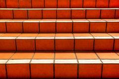 Orange tiled stairs texture going upwards Royalty Free Stock Images