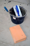 Orange tiles with bucket Stock Images