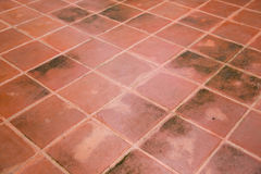Orange tiles floor background, orange tile architecture wallpaper and background. Red brick paving stones on a floor. Red Brick floor tile with cross line royalty free stock images