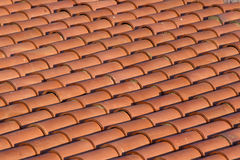 Orange tiles of a new home.  Beautiful background of clay tiles. Orange tiles of a new home. Background of clay tiles Stock Photo