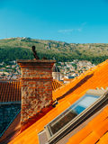 Orange tiles on roof. Croatian architecture Royalty Free Stock Photography