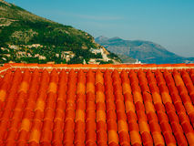 Orange tiles on roof. Croatian architecture Royalty Free Stock Photo