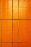 Orange tiles wall Stock Photos