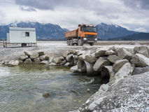 Orange tipper in the drained Forggensee Stock Images