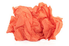Orange Tissue Paper. Crumpled orange tissue paper over white background Royalty Free Stock Photos