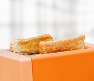 Orange toaster with two slices of bread Royalty Free Stock Photography