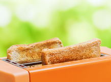 Orange toaster with two slices of bread Stock Photos