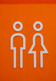Orange toilet sign Stock Photo