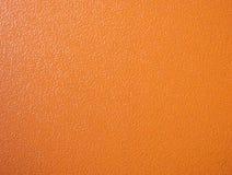 Orange tom bakgrund för lutningtextur arkivfoto