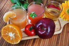 Orange tomato and apple juice Royalty Free Stock Photo