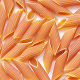 Orange tomatoe flavored pasta penne Royalty Free Stock Photos
