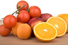 Orange, Tomatoes, peach and plums Royalty Free Stock Photos