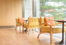 Orange tone bright cafe restaurant seating. Area Stock Photos