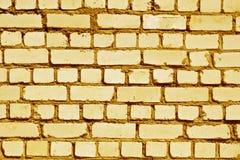 Orange toned rough brick wall pattern. Royalty Free Stock Photography